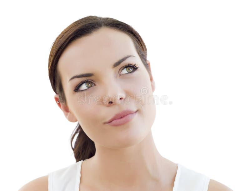 Giovane donna adulta pensierosa che cerca sul bianco fotografie stock libere da diritti
