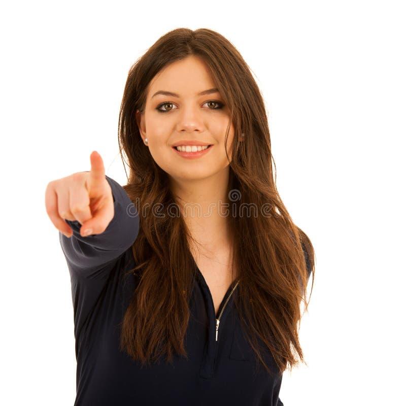 Giovane donna attraente che indica lo spazio della copia isolato sopra briciolo immagine stock