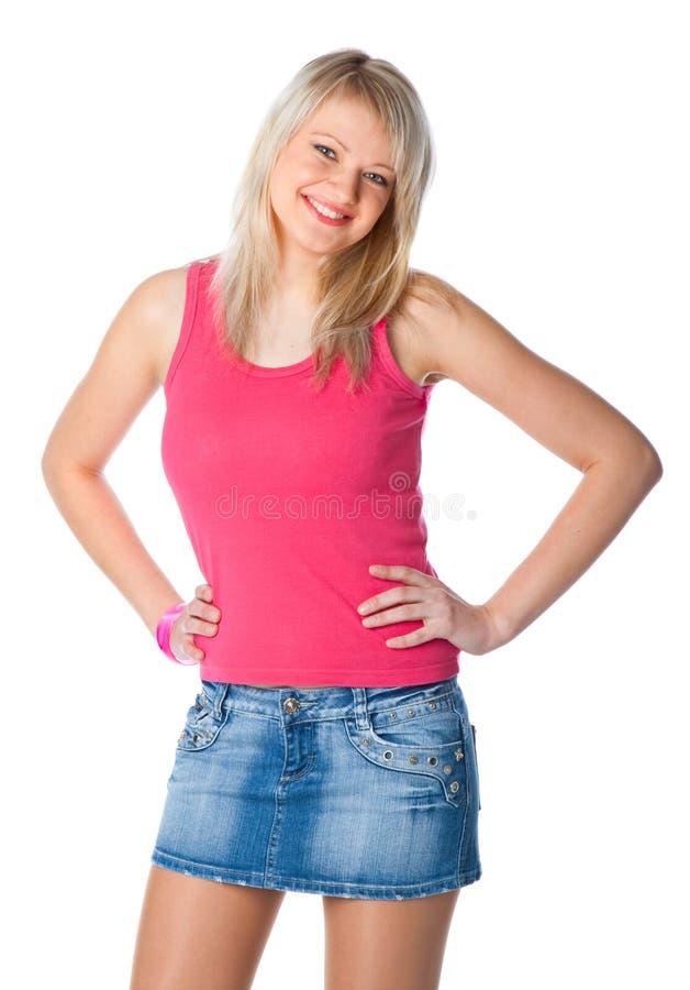Giovane donna attraente in miniskirt fotografia stock