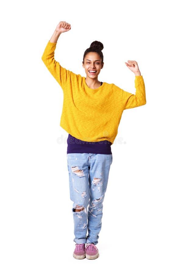 Giovane donna che celebra successo fotografia stock