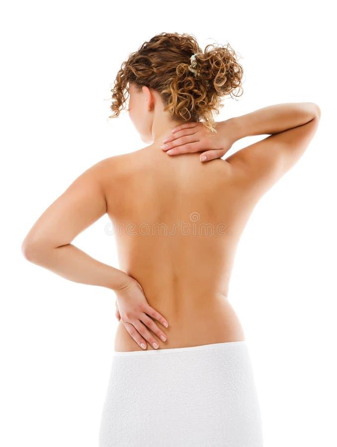 Donna che massaggia la parte posteriore di dolore fotografia stock libera da diritti