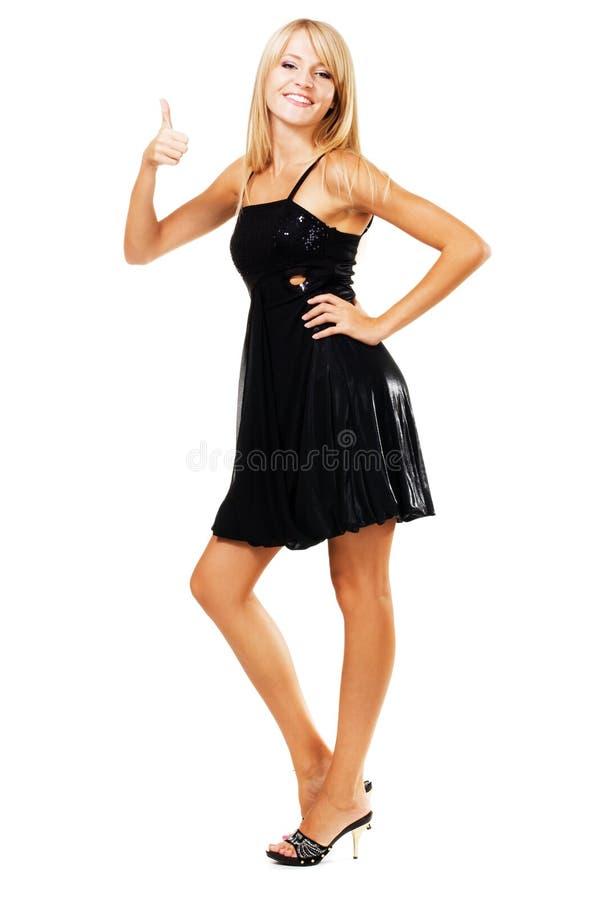 Giovane donna che mostra i pollici in su immagini stock
