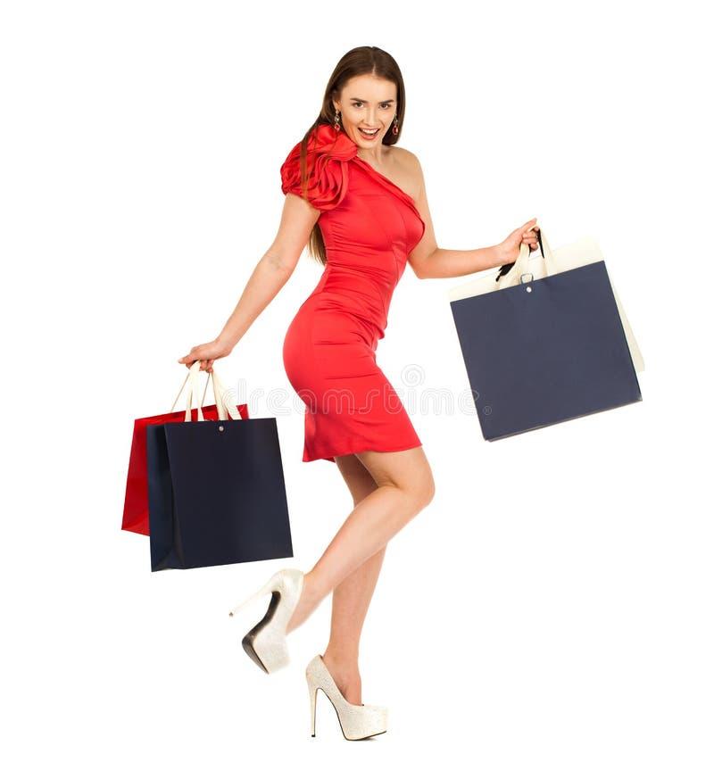 Giovane donna con alcuni sacchetti della spesa fotografia stock libera da diritti