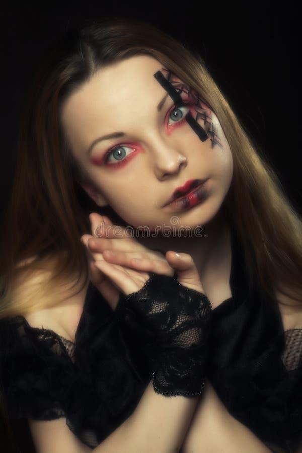 Giovane donna con fronte-arte creativa fotografia stock