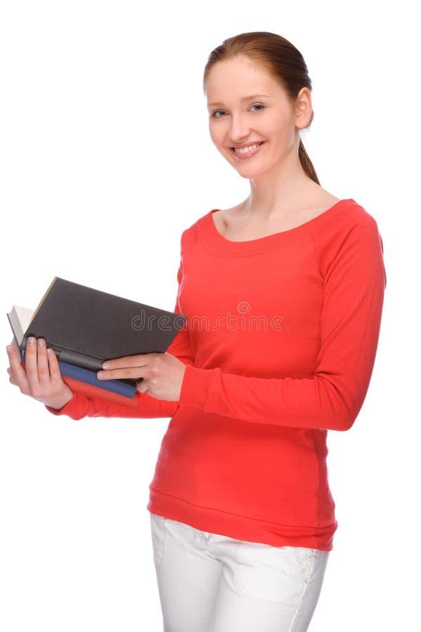 Giovane donna con i libri immagini stock