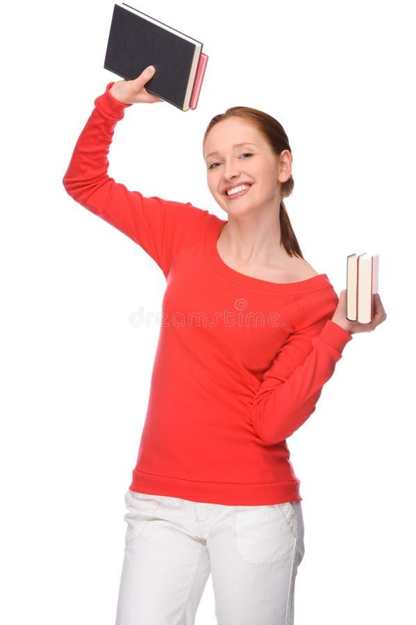 Giovane donna con i libri fotografia stock