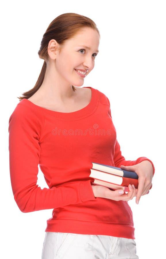 Giovane donna con i libri fotografie stock