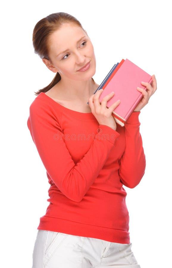 Giovane donna con i libri immagine stock