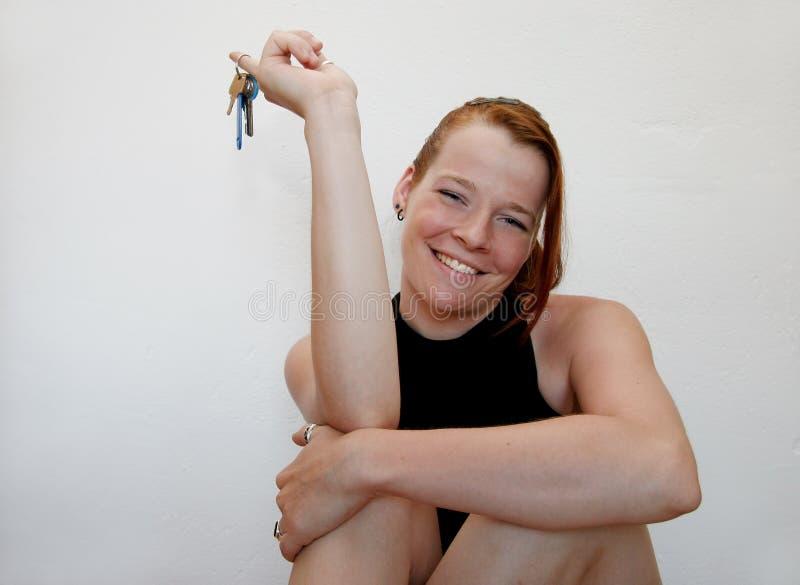 Giovane Donna Con I Tasti Fotografia Stock