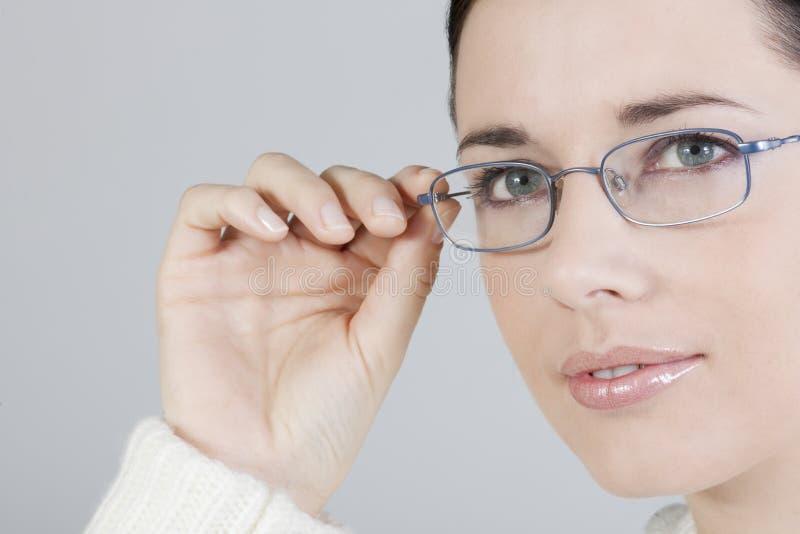 Giovane donna con i vetri fotografia stock