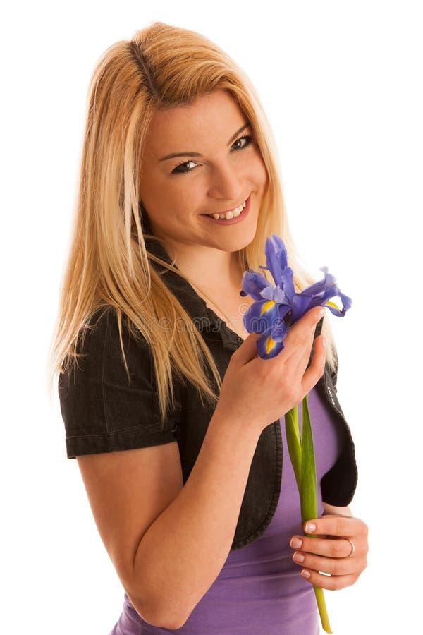 Giovane donna con il fiore dell'iride isolato sopra fondo bianco immagine stock