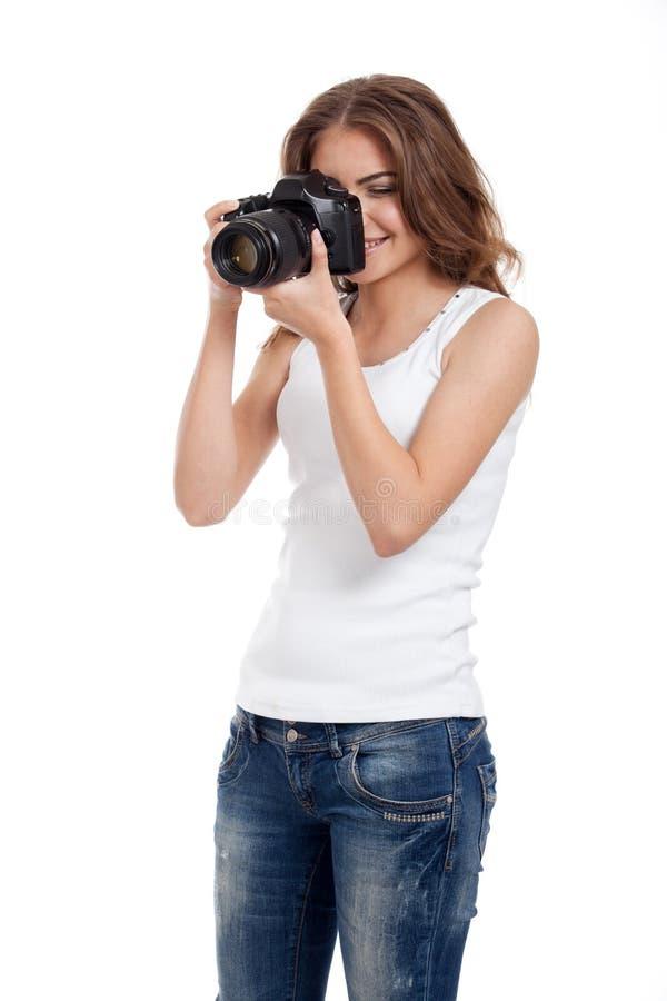 Giovane donna con la macchina fotografica della foto fotografia stock libera da diritti