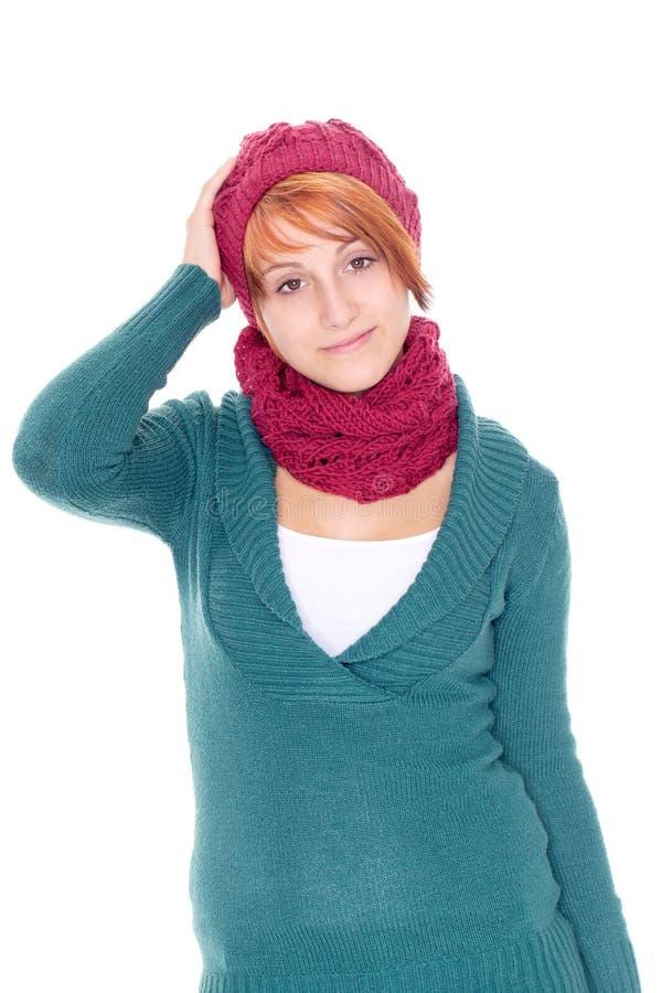 Giovane donna con la sciarpa e la protezione fotografie stock
