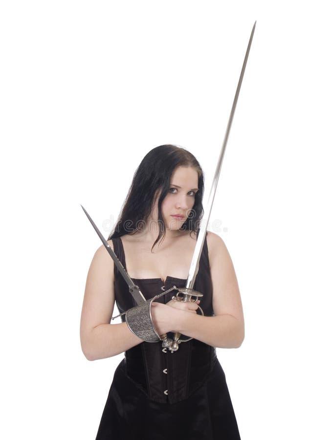 Giovane donna con la spada fotografia stock libera da diritti