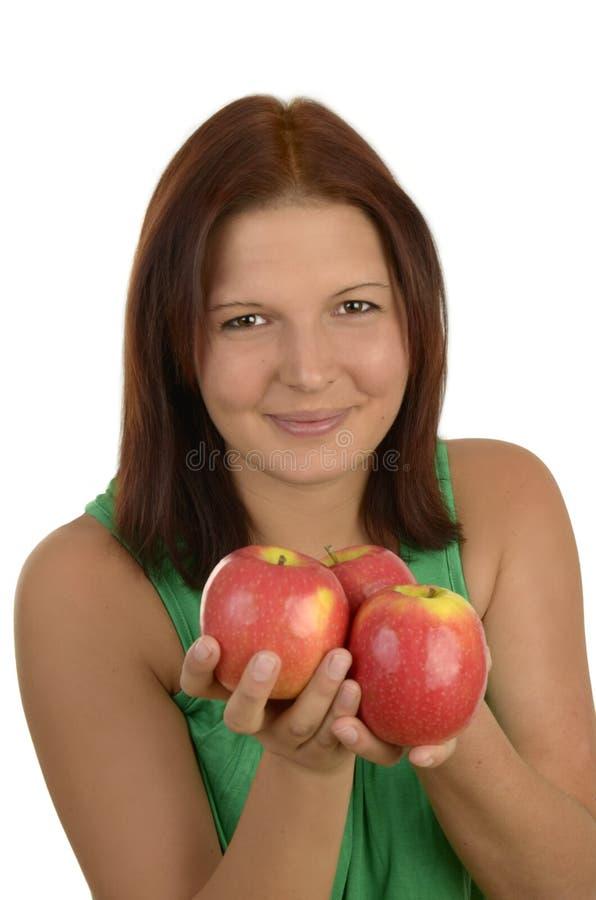 Giovane donna con le mele fotografia stock