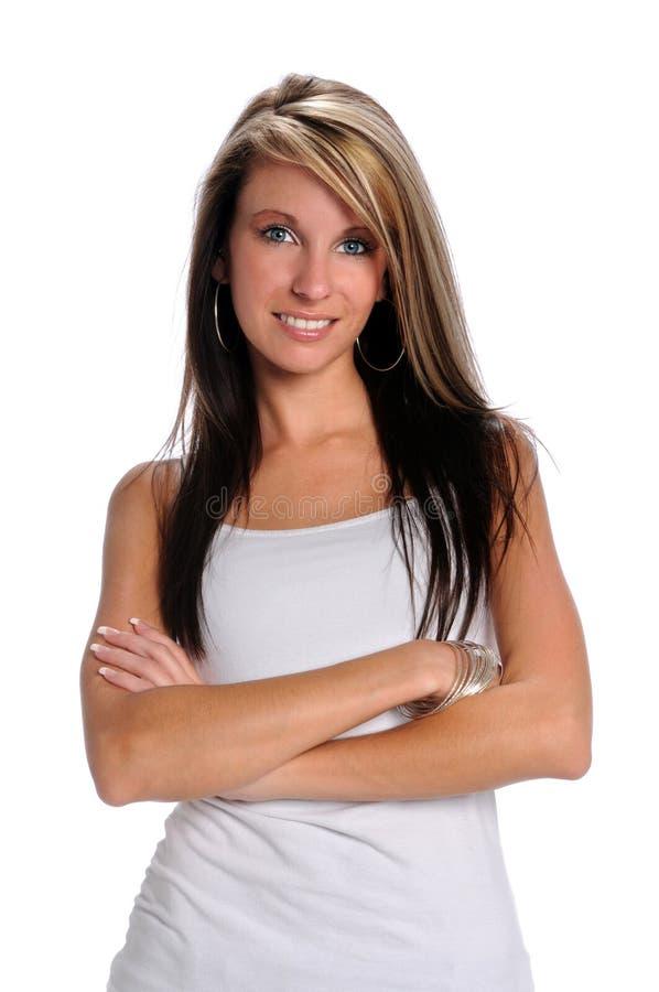 Giovane donna con le traverse delle braccia fotografia stock