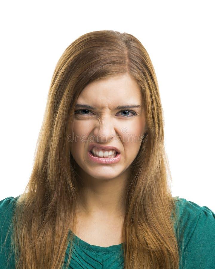 Giovane donna con un fronte disgustoso immagine stock libera da diritti