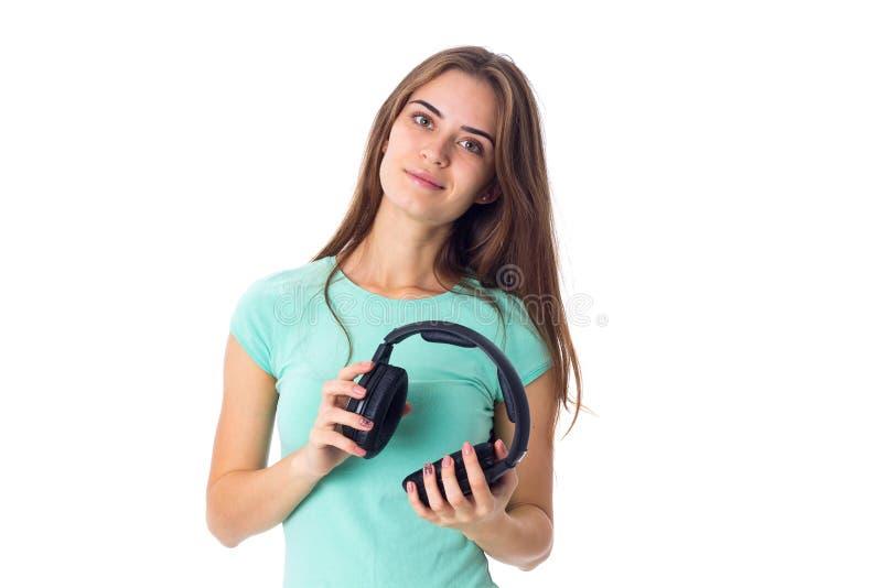 Giovane donna in cuffie fotografie stock libere da diritti