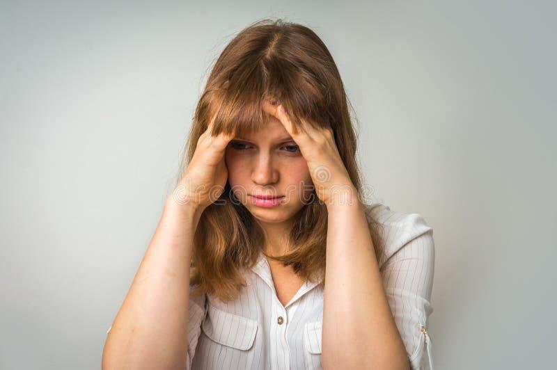 Giovane donna deludente nella depressione fotografia stock