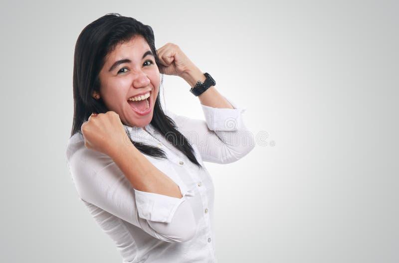 Giovane donna di affari asiatica Showing Winning Gesture fotografia stock