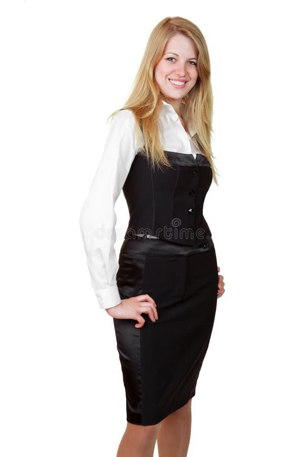 Giovane donna di affari che si leva in piedi con la mano sull'anca fotografie stock libere da diritti