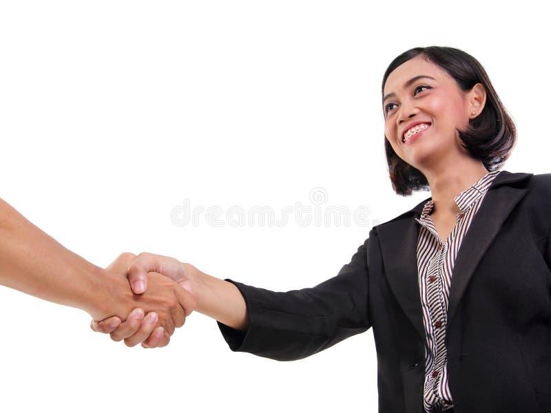 Giovane donna di affari che stringe mano, fondo bianco fotografia stock