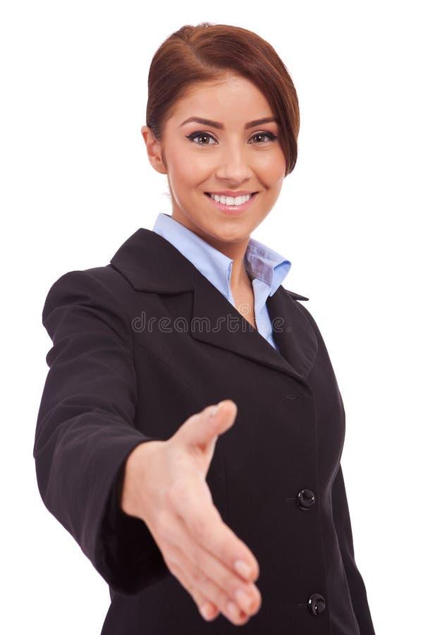 Giovane donna di affari che wlecoming alla squadra immagine stock