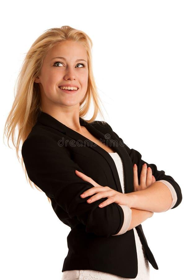 Giovane donna di affari con capelli biondi e gli occhi azzurri che gesturing l'Unione Sovietica fotografia stock libera da diritti