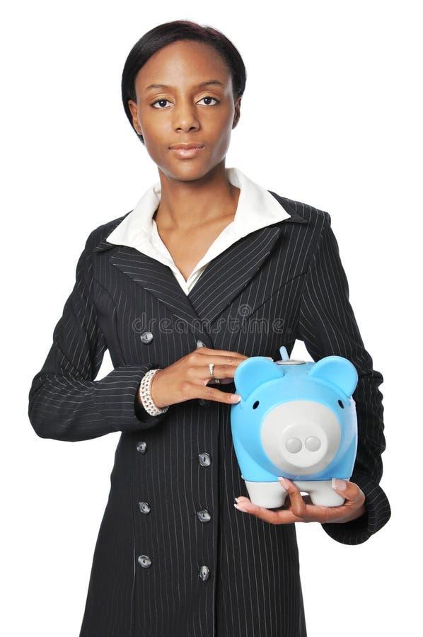 Giovane donna di affari con la Banca Piggy fotografia stock libera da diritti