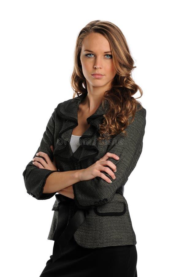 Giovane donna di affari con le braccia attraversate fotografia stock