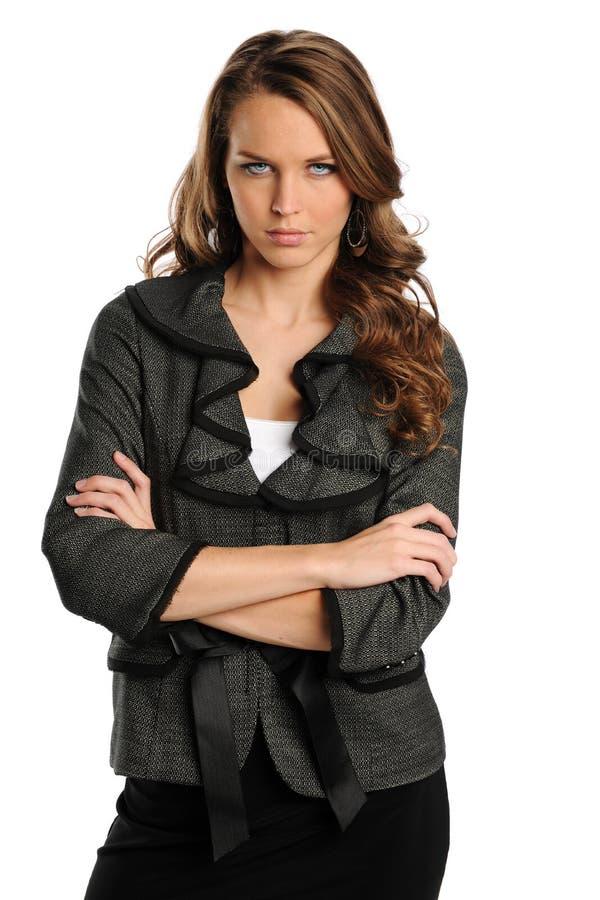Giovane donna di affari con le braccia attraversate fotografie stock