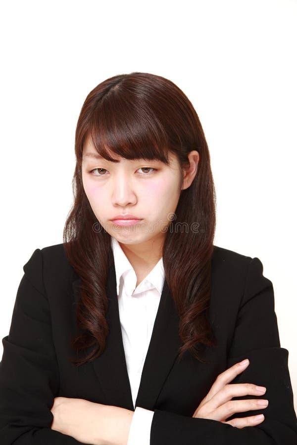 giovane donna di affari giapponese arrabbiata fotografia stock