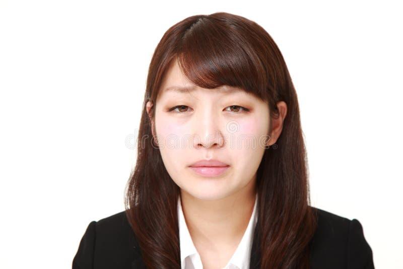 giovane donna di affari giapponese triste fotografia stock libera da diritti