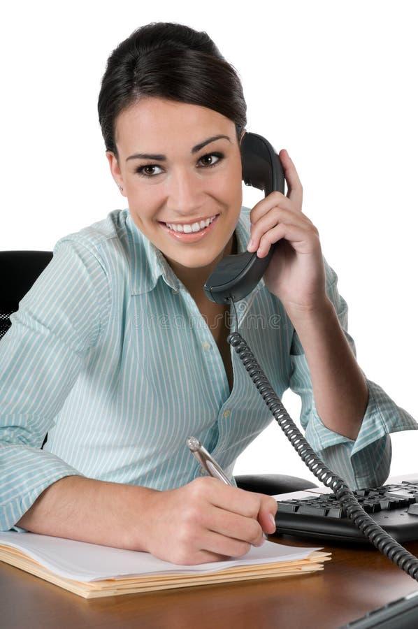 Giovane donna di affari sul telefono, isolato fotografia stock