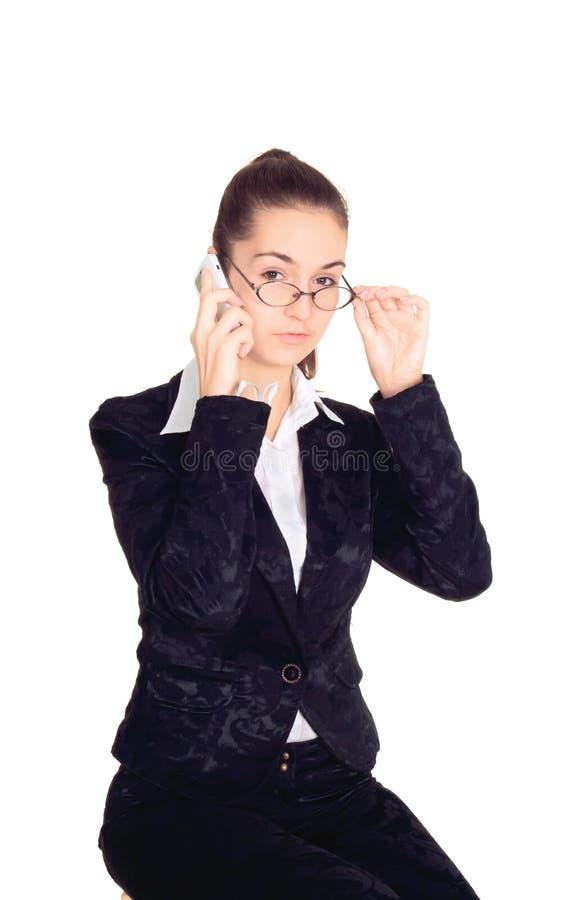 Giovane donna di affari in vetri fotografia stock