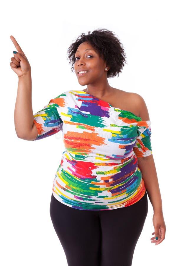 Giovane donna di colore che indica su - la gente africana immagini stock libere da diritti