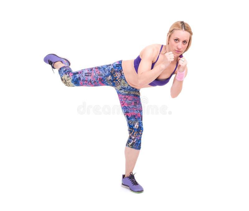 Giovane donna di sport che fa esercizio di forma fisica fotografia stock