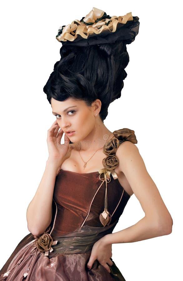 Giovane donna di stile Rococo che si leva in piedi in vestito sopra wh fotografie stock libere da diritti