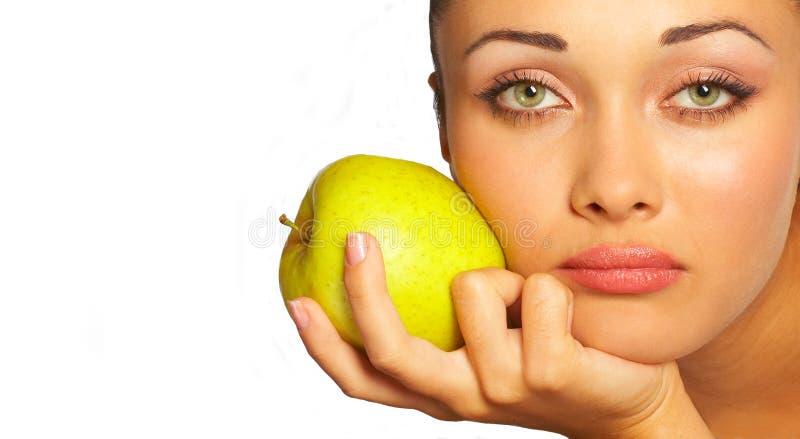 Giovane donna e mela verde fotografia stock