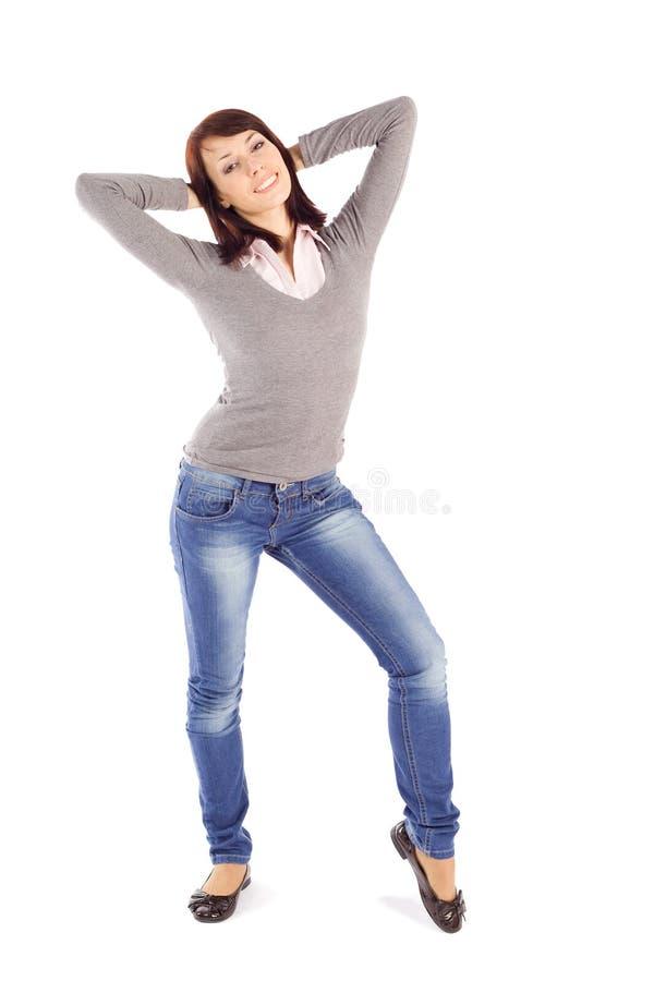 Giovane donna felice casuale nella posa Relaxed immagini stock