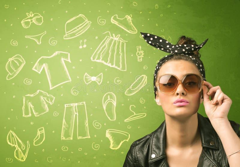 Giovane donna felice con le icone dell'abbigliamento casual e di vetro fotografia stock
