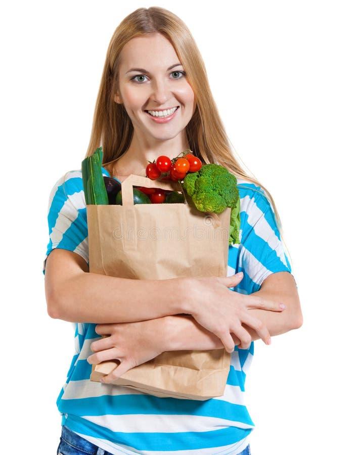 Giovane donna felice con le verdure immagini stock libere da diritti