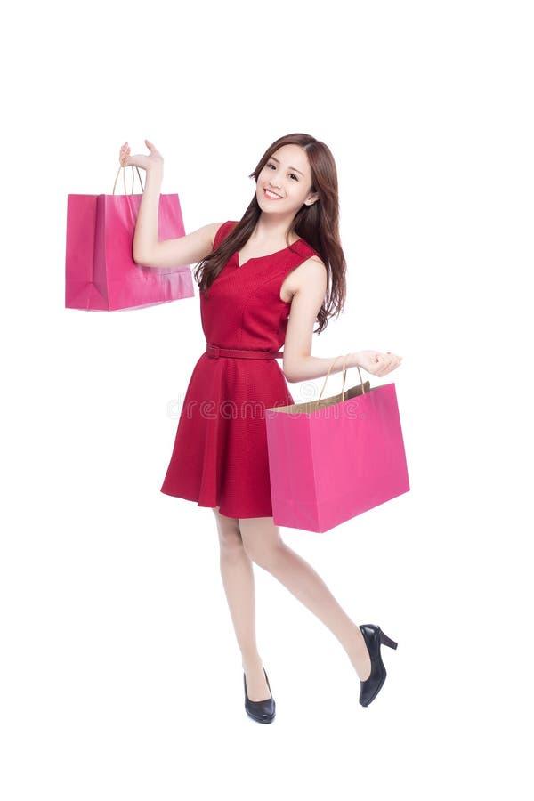 Giovane donna felice di acquisto fotografie stock libere da diritti