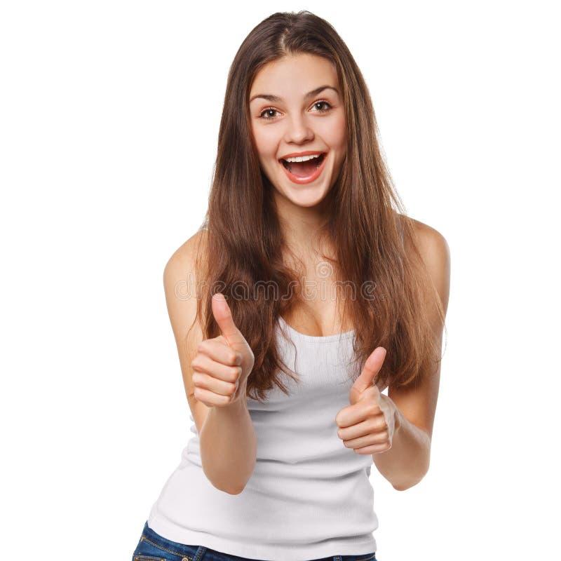 Giovane donna felice sorridente che mostra i pollici su, isolato su fondo bianco fotografie stock libere da diritti