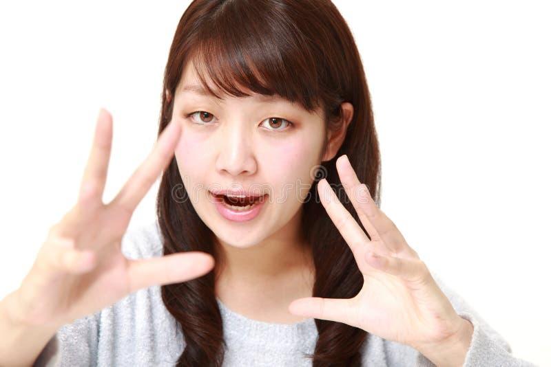 Giovane donna giapponese con potere soprannaturale immagine stock