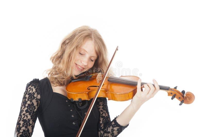 Giovane donna graziosa che gioca violino immagine stock
