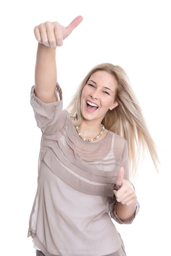 Giovane donna graziosa con i pollici su su fondo bianco fotografie stock