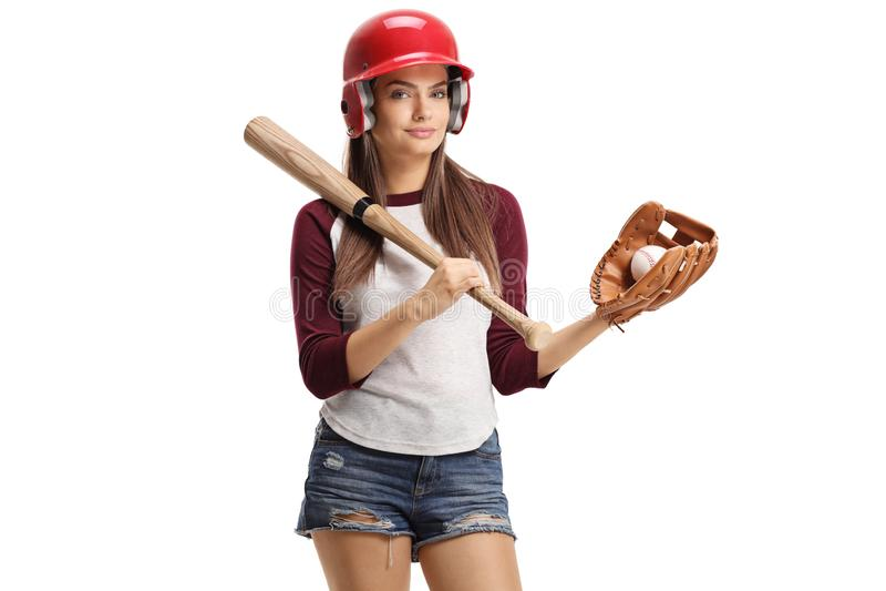 Giovane donna graziosa con l'attrezzatura di baseball immagini stock