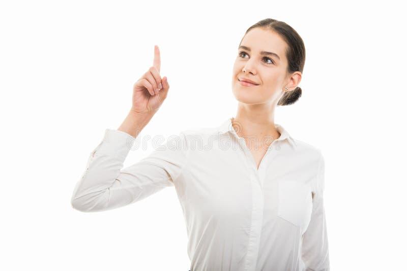 Giovane donna graziosa di affari che indica dito sul gesto fotografie stock libere da diritti