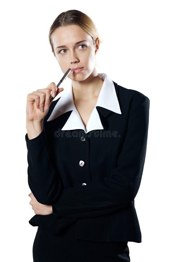 Giovane donna imbarazzata isolata di affari con una penna immagini stock
